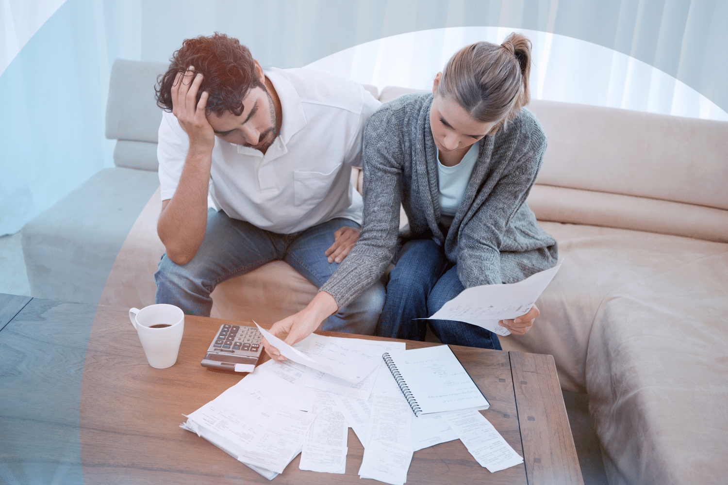 Picture of stressed couple reviewing bills